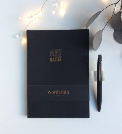 Black notebook and pen bundle